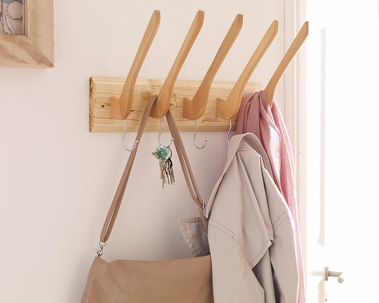 Upcycle old wooden hangers into this unique coat rack with Dremel.