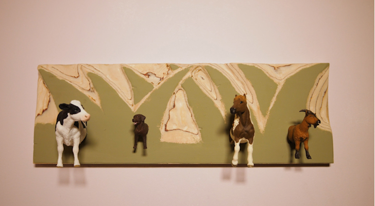 Upcycle toy animals into a cool coat rack.