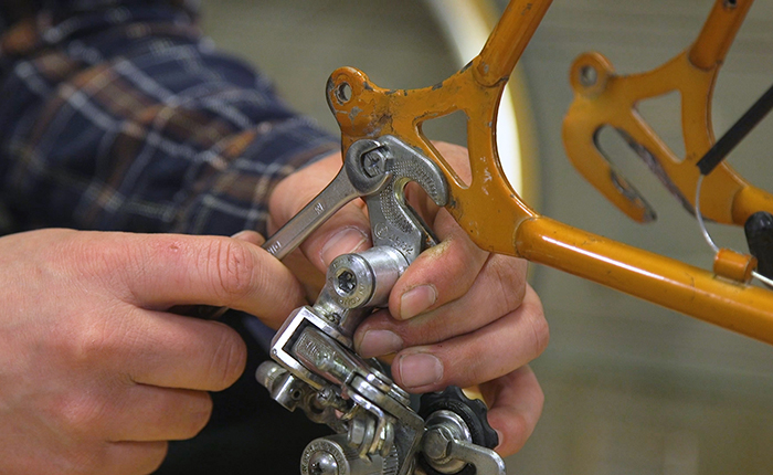 Slide the derailleur back on its hanger, align it and tighten the bolts.