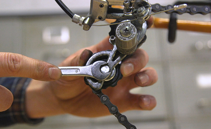 Carefully guide the chain back in its correct place and pop in the wheel.