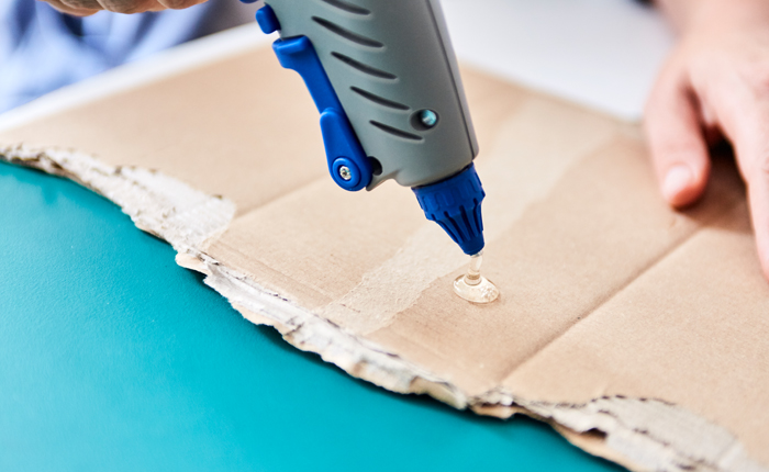 Before using the glue gun, test the glue on a piece of scrap material.