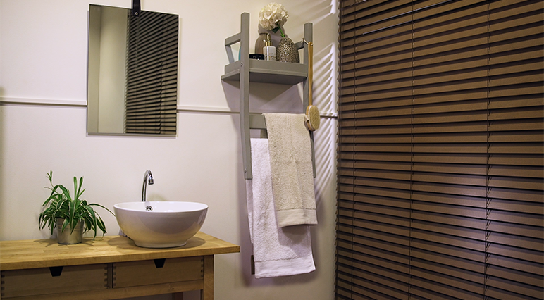 Discover how to upcycle an old chair into a chic towel rack and bathroom shelf