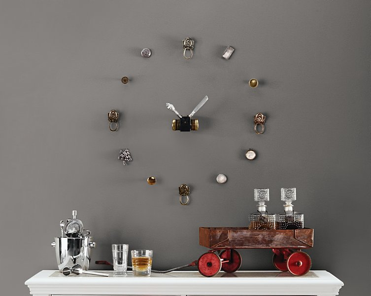 Create a unique wall clock out of vintage silver and brass pieces.