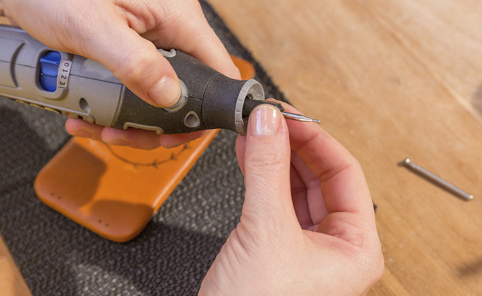 For engraving leather, a High Speed Cutter works best.